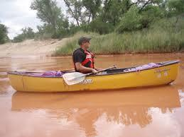 a man in a yellow canoe