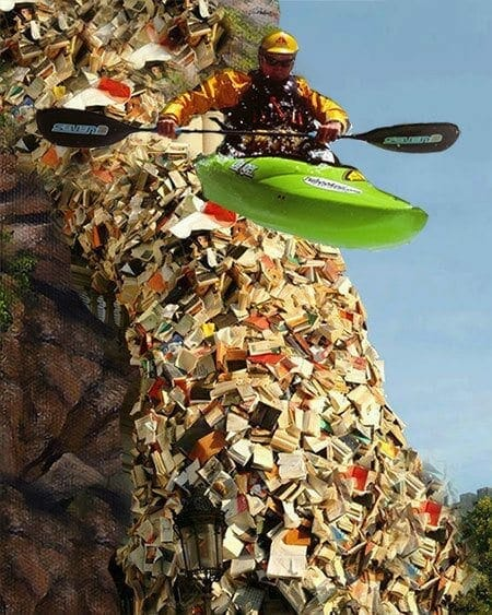 a man kayaking in a river of books