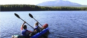 two people in a sea eagle kayak