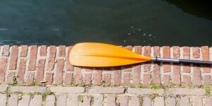 orange paddle on cement